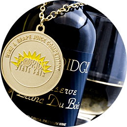 Bottle of Lakeridge Winery Blanc Du Bois wine with a gold medal from the Florida State Fair wine competition.