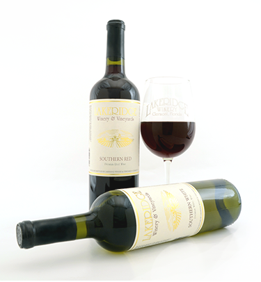 A bottle of Southern Red and Southern White wine with a glass of red wine.